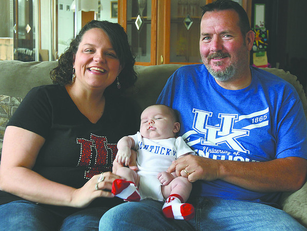 The Taggart home in New Albany will be divided for the NCAA Sweet Sixteen basketball game between Indiana University and the University of Kentucky. Stephanie Taggart is a Indiana fan and her husband Todd Taggart roots for Kentucky. Their eight-week-old son Cole is currently un decided. Staff photo by C.E. Branham