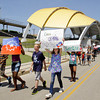 Participants from Parkview, Beechwood, Riverside, and Griffin recreation centers march along East Water Street following a history lesson at the Riverfront Amphitheater during their Juneteenth celebration on Tuesday afternoon in New Albany. Juneteenth is a national holiday that commemorates the end of slavery. Staff photo by Christopher Fryer