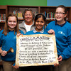 Sheila Noon, principal at St. Anthony of Padua Catholic School, stands with a proclamation honoring her for winning the Archdiocese of Indianapolis' Principal of the Year award. Eighth-graders Grace Kempf, Anoosha Sri and Katie Baker stand with her. Noon has worked at the school for 43 years, seven of those as the principal. The school has never received the award before. Noon also received a nomination for the National Catholic Education Association's Principal of the Year award and will find out if she won in December. Staff photo by Jerod Clapp