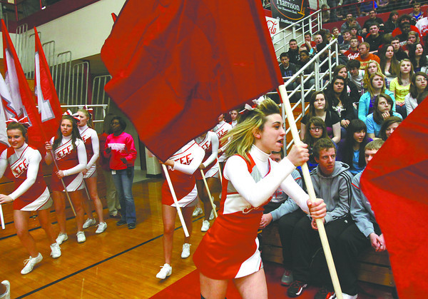The Jeffersonville High School cheerleaders circle William S. Johnson Arena at the start of a pep rally Friday afternoon for the semistate bound Red Devils. Jeffersonville and Borden play in Seymour Saturday for a semistate title. Staff photo by C.E. Branham
