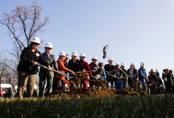Hosparus Southern Indiana staff members take part in a groundbreaking ceremony at their future location along Hausfeldt Lane in New Albany on Thursday morning. Staff photo by Christopher Fryer