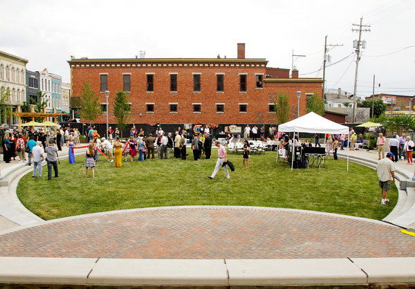 Spectators gather following a ribbon cutting ceremony at the official opening of the Bicentennial Park at the corner of Spring and Pearl streets in downtown New Albany on Friday evening. Staff photo by Christopher Fryer