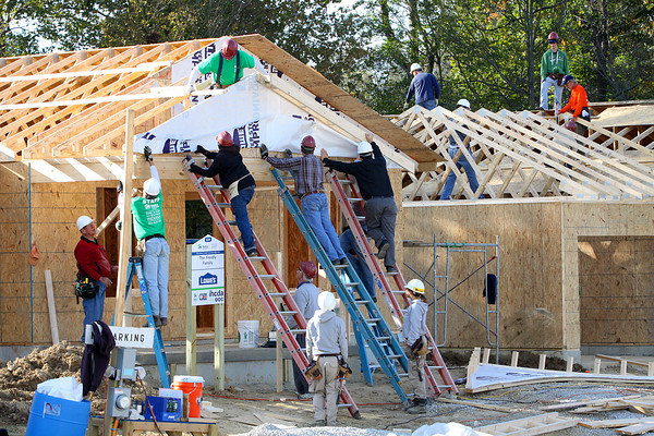 Habitat for Humanity workers are building ten homes in Twin Oaks subdivision in Henryville. The homes are expected to be finished, and families moved in, by mid-December. Staff photo by C.E. Branham