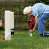 Hilda Watson of New Albany places flowers on the grave of her brother, Col. Paul Frederick Johns, prior to Memorial Day services at the New Albany National Cemetery. Col. Paul F. Johns, a pilot in the United States Air Force, went missing in 1968 while flying a mission over Southeast Asia. His body was never recovered. Staff photo by C.E. Branham