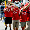 The Jeffersonville High School marching band plays the school fight song as they march in the city of Jeffersonville Celebrating Freedom Parade. Staff photo by C.E. Branham