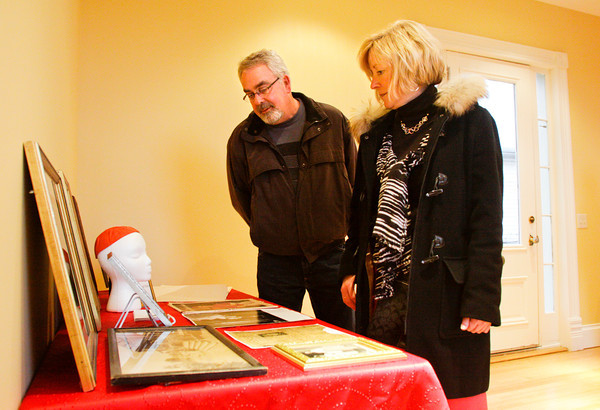 Lauren Johnson, of Louisville, and her brother John Blocker, of New Albany, look at Cardinal Joseph E. Ritter memorabilia on display in the museum of the Cardinal Ritter House, located along East Oak Street in New Albany. Staff photo by Christopher Fryer