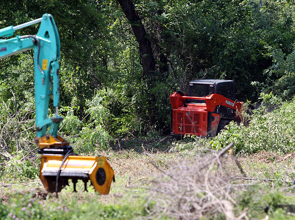 The City of Jeffersonville began clearing a brownfield at the corner of Allison Lane and Middle Road Monday to make way for a new park. Staff photo by C.E. Branham