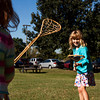 Tessa Perotti, 6, Bloomington, right, plays lacrosse with Lilli Paris, 6, Floyds Knobs, at the games and atlatls station during the annual Archaeology Day at Falls of the Ohio State Park in Clarksville on Saturday morning. Staff photo by Christopher Fryer