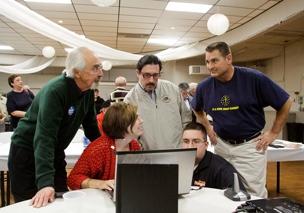 Floyd County Democrats watch as results come in at the Knights of Columbus hall in New Albany on Tuesday night. Staff photo by Christopher Fryer
