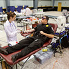 Red Cross automated collection technician Jessica Cook, of Louisville, sets up Lt. Eric Mills, of the Salem Police Department, for a blood donation during the Frank Denzinger Memorial Blood Drive in the Centrum Room at Northside Christian Church in New Albany on Tuesday afternoon. Denzinger was killed in the line of duty in 2007 while serving as an officer for the Floyd County Sheriff's Department and the blood drive is part of the statewide Indiana Fallen Officer Blood Drive. Staff photo by Christopher Fryer