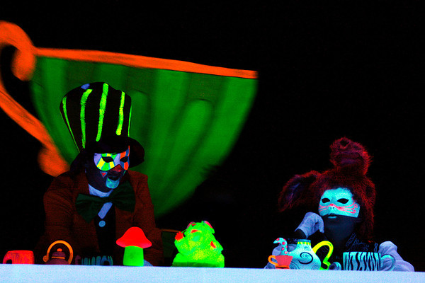 "Micah Landers, sophomore, and Ashlyn Gross, eighth-grader, practice a scene in Silver Creek High School's production of ""Alice."" The entire show is illuminated by black lights. Staff photo by Jerod Clapp"