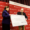 Indiana University Southeast Chancellor Sandra Patterson-Randles accepts a check for $500,000 dollars from Judge Carlton Sanders in the Hoosier Room East at IU Southeast on Friday afternoon. The donation will be used to improve and expand an existing facility into The Judge Carlton and Sue Sanders Laboratory for Nursing Education. Staff photo by Christopher Fryer