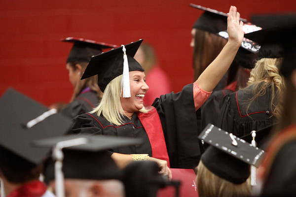 Kassandra Hill waves to family before the 45th commencement Monday afternoon at Indiana University Southeast. Staff photo by C.E. Branham