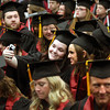 Indiana University Southeast students snap a photo together before the school's 45th commencement Monday afternoon. Staff photo by C.E. Branham