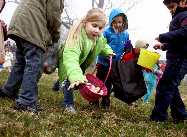 Madalynn Kessinger swoops in on a egg at the Clarksville Parks Department annual Easter egg hunt Saturday at Colgate Park. Staff photo by C.E. Branham