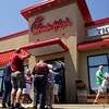 "Customers wait to enter the Chick-fil-A on State Street in New Albany during ""Chick-fil-A Appreciation Day"" on Wednesday afternoon. The nationwide event was organized by former Republican presidential candidate Mike Huckabee to support the company's president's recent comments about his support of traditional marriage. Staff photo by Christopher Fryer"