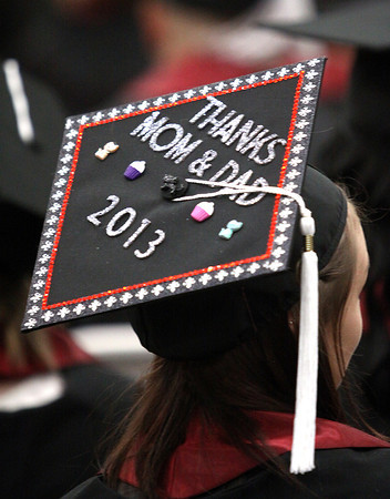 A Indiana University southeast student uses her mortar board to thank her parents at the school's 45th commencement Monday afternoon. Staff photo by C.E. Branham