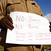 Kenneth Long, of New Albany, holds a protest sign in front of the New Albany-Floyd County Consolidated School Corporation Administration Services Center along Grant Line Road in New Albany on Wednesday morning. Long and other protestors present at the event do not believe that administration officials properly handled an incident involving student costumes at a Highland Hills Middle School basketball game against Parkview last month that were perceived by some to be racist. Staff photo by Christopher Fryer