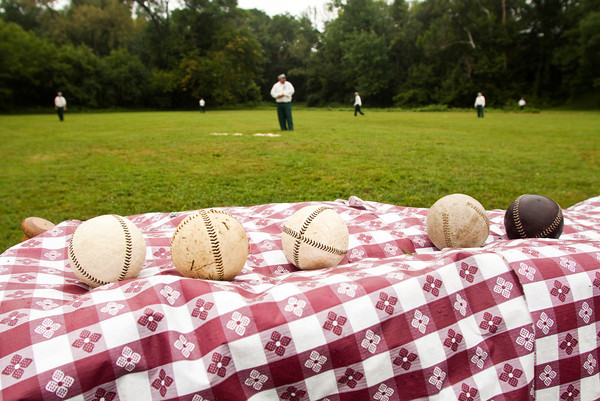 Vintage style baseballs sit on the sidelines as the Huntington Champion Hill Toppers play the Cincinnati Buckeyes in an old fashioned baseball game at Binford Park in New Albany on Saturday. Staff photo by Christopher Fryer