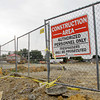 Caution tape blows in the wind around the perimeter of the commercial development construction site on the 2200 block of State Street in New Albany on Friday afternoon.Several businesses, including Bob Evans, Tire Discounters, and First Community Bank will be located on the site where the Wesley Chapel United Methodist Church was formerly located. Staff photo by Christopher Fryer