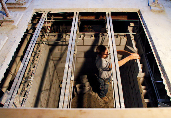 Brad Devore, of Corydon, works on the masonry of a new elevator shaft being installed in the St. Marks United Church of Christ Education Building on Thursday morning in New Albany. Staff photo by Christopher Fryer