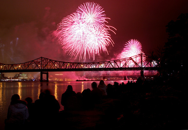 Spectators in Jeffersonville watch from the riverfront as fireworks explode above the Ohio River during Thunder Over Louisville on Saturday night. Staff photo by Christopher Fryer