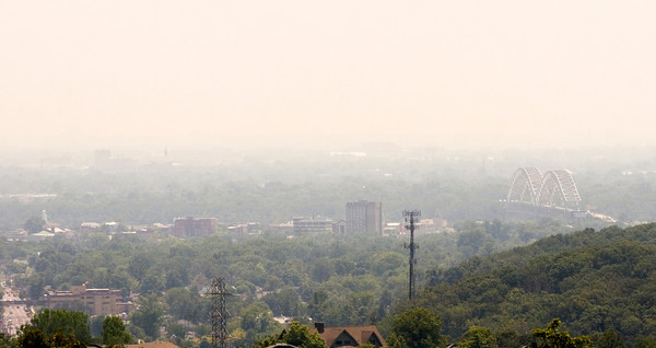 A thick, summer haze hangs over New Albany as temperatures push towards triple digits on Friday afternoon. According to the National Weather Service, highs will remain in the 100s until Monday. Staff photo by Christopher Fryer
