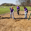 Kohl's Cares volunteers do mulch work during the cleanup day at Sam Peden Community Park in New Albany on Saturday morning. Staff photo by Christopher Fryer