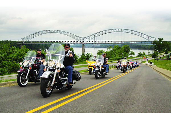 Motorcycle riders begin their route at the New Albany riverfront during the Armed Forces Appreciation Day motorcycle parade on Saturday morning. Staff photo by Christopher Fryer
