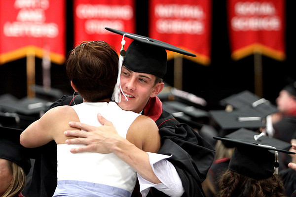 Blake Neumann is hugged by his mother Jae Neumann before commencement ceremonies Monday at Indiana University Southeast. Staff photo by C.E. Branham