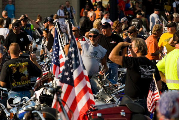 Motorcyclists congregate in the front parking lot of S & S Powersports in Clarksville as they wait to escort  the American Veterans Traveling Tribute Vietnam Wall on a tour of the area on Wednesday evening. Staff photo by Christopher Fryer