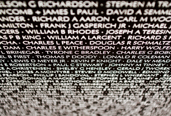 Over 58,000 names are inscribed on the American Veterans Traveling Tribute Vietnam Wall, which is an 80-percent scale replica of the Vietnam Veterans Memorial in Washington D.C. Staff photo by Christopher Fryer