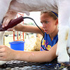 Breann Hendrickson clips a goat Wednesday morning to get it ready to show in the Clark County 4-H Fair Market Wether Goat Show. Staff photo by C.E. Branham