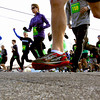 Runners head east on Chestnut St. in downtown Jeffersonville at the start of the annual two-mile Leprechaun Run Tuesday evening. Staff photo by C.E. Branham