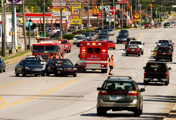 Emergency crews work the scene of an injury accident involving two vehicles along the 2200 block of State Street at about 4:30 p.m. on Tuesday in New Albany. Staff photo by Christopher Fryer