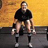 Rachel Kellington, of Louisville, does a dead lift during a CrossFit competition at Clark Floyd CrossFit in New Albany on Saturday morning. Kellington placed first in the women's competition and Charlie Sims, of Louisville, placed first in the men's. The owner of the facility, Case Belcher, graduated from Henryville High School in 2005 and held the event to raise tornado relief funds for the school's athletic department. Staff photo by Christopher Fryer