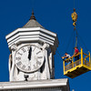 Sub-contractors Terry West, left, and Robert Bottorff take measurements on the clock tower and front facade of the Second Baptist Church during a structural analysis of the historic building in downtown New Albany on Wednesday morning. Staff photo by Christopher Fryer