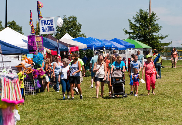 Attendants move between booths during Sellersburg Celebrates at Silver Creek Community Park on Saturday afternoon. Staff photo by Christopher Fryer