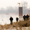 Members of the New Albany Police Department work a crime scene along the Ohio River bank after the crew of a passing barge spotted the remains of an unidentified, white female at about 10:35 a.m. on Friday near the Riverside/QRS Recycling facility in New Albany. Staff photo by Christopher Fryer