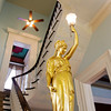 A light fixture sits at the base of a staircase in the Pepin Mansion, located at 1003 E. Main St., in New Albany on Thursday afternoon. Owner Ron Smith held an official grand opening for the restored home on Thursday, which he is operating as a retreat center, rehearsal hall and bed and breakfast. Staff photo by Christopher Fryer