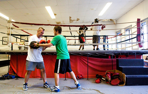 Duane Pierce, left, and his son Steve, both of Lanesville, train with mitt work in the boxing gym of Terry Middleton's martial arts school in downtown New Albany on Wednesday evening. Middleton offers training in boxing, kickboxing, mixed martial arts, and karate and has been in business for 40 years. Staff photo by Christopher Fryer