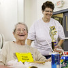 Vivian Boorse, left, 97, of the Lincoln Hills Health Center, smiles for photographs after she received the Oldest Female Award following the Nursing Home Games at the Salvation Army in New Albany on Wednesday morning. More than 40 seniors competed in floor basketball, toss 'em, ring toss, and bucket blast competitions as part of the LifeSpan Resources 2013 Senior Games. Staff photo by Christopher Fryer