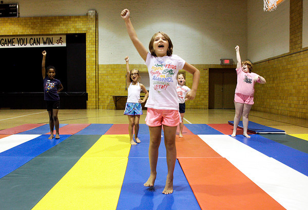 Chelsie Glover, 8, of New Albany, leads her fellow campers during cheer exercises at the New Albany-Foyd County Parks Department Cheer Clinic in the gymnasium at the Griffin Center in New Albany on Thursday afternoon. A total of six participants were coached by instructors on tumbling, cheering, stunts, and other aspects of cheerleading during the clinic for six to 11-year-olds. Staff photo by Christopher Fryer