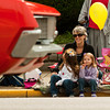 Erin Kaiser, of Greenville, sits with her daughters Ruthie, 5, left, and Allie, 3, as they watch the Harvest Homecoming Parade move down Spring Street in New Albany on Saturday afternoon. Staff photo by Christopher Fryer