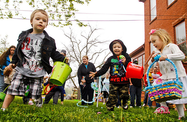 Children take off into the west lawn at the beginning of the five and under Easter egg hunt at the Howard Steamboat Museum in Jeffersonville on Saturday morning. Staff photo by Christopher Fryer
