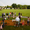 "A rainbow appeared on the horizon as relatives gathered at a memorial site in honor of Jacqueline Hall, who passed away on Jan. 17 of this year, in Bicknell Park on Wednesday evening in New Albany. ""Show us the rainbow grandma,"" Denise Hall said as she dug a hole after the rain stopped. Denise, Hall's daughter-in-law, was one of several relatives from three generations that were on hand to remember her and to help plant flowers, bushes and trees at the memorial in the park that she lived next to on Spring Street for many years. Staff photo by Christopher Fryer"