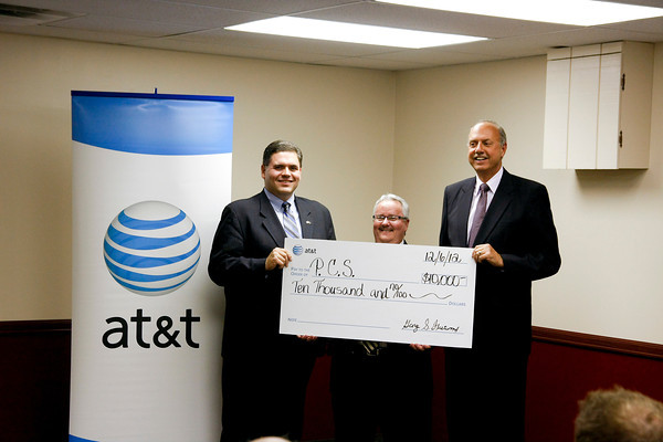 State Rep. Ed Clere, Personal Counseling Services executive director Doug Drake and AT&T Indiana president George Fleetwood, stand with a $10,000 check for Personal Counseling Services. The organization will use the money to help students keep from dropping out of high school. Staff photo by Jerod Clapp