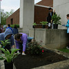 Dawn Quinn, her daugher Ruby, Henry Huynh, a sixth-grader at Hazelwood and Robin Ballard, a fifth-grade instructional assistant, plant hostas and other plants in the planters outside of Hazelwood's entrance. About 60 volunteers came out to participate in Hazelwood Gives a Day in spite of the rainy weather. Staff photo by Jerod Clapp