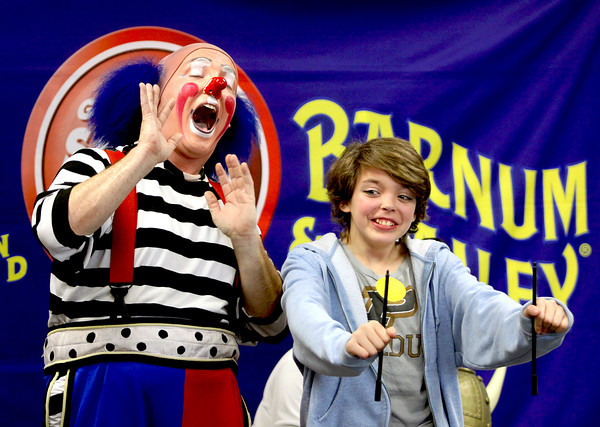 Kaitlyn Williams of Bethlehem participates in a skit with Ringling Brothers and Barnum and Bailey Circus clown Dave Friday morning at the Sellersburg Library. Clowns Dave and Cherie read to the kids and parents and performed a routine. Staff photo by C.E. Branham