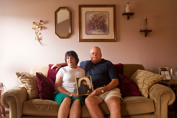 Janice and Frank Renn hold a photograph of their daughter Kimberly Camm in their New Albany home on Saturday morning. Camm, her daughter, Jill, 5, and her son, Bradley, 7, were all shot to death at their Georgetown home in 2000. David Camm, Kimberly's husband, and the children's father, is accused of the killings. Staff photo by Christopher Fryer